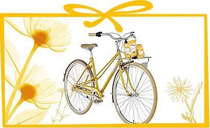 gelbes Damenrad mit Botanicals Produkten